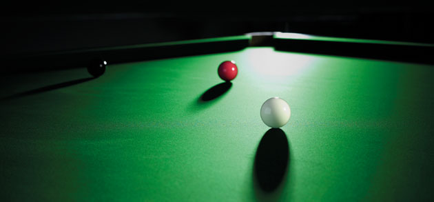 green cloth and cue ball, red and black